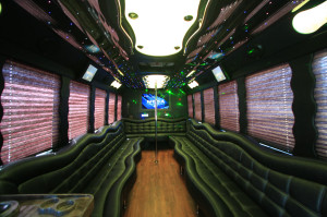 Party bus interior with stripper pole